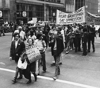 Uploads 2f1539180584191 pr02y5h5bo 118f84ca74c7abf1e3bf2538cc29fc3a 2fjeanne manford marching with her famous sign in a pride parade in 1972 e1499555048603.jpg?ixlib=rails 2.1